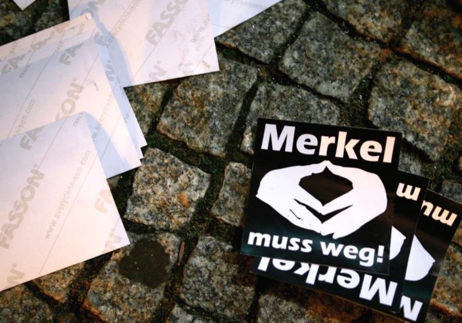 STICKERS WITH the words 'Merkel must go' lie on the pavement during a protest in Berlin.