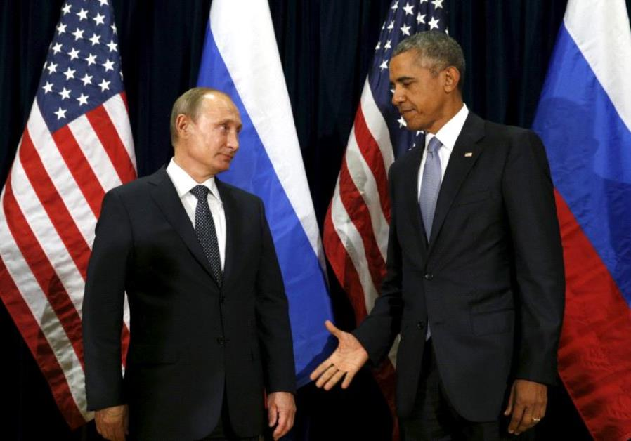 U.S. President Barack Obama extends his hand to Russian President Vladimir Putin during their meetin
