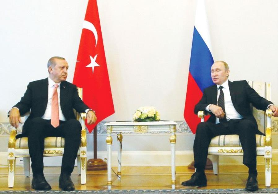 RUSSIAN PRESIDENT Vladimir Putin (right) speaks to Turkish President Recep Tayyip Erdogan during the