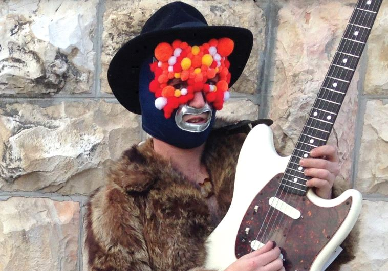 JERUSALEM MUSICIAN Eli Schabes wrestles with his music as the one-man looping band Maz Gan.
