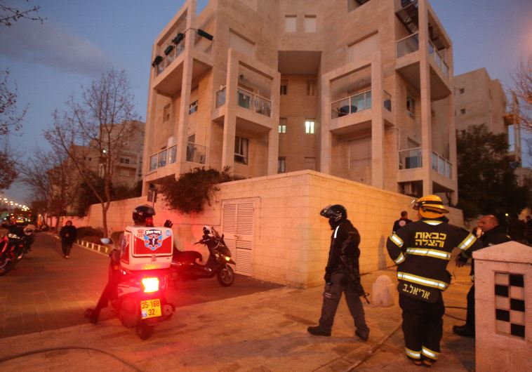 Emergency services outside the Jerusalem aparment building where a mother and four children died in