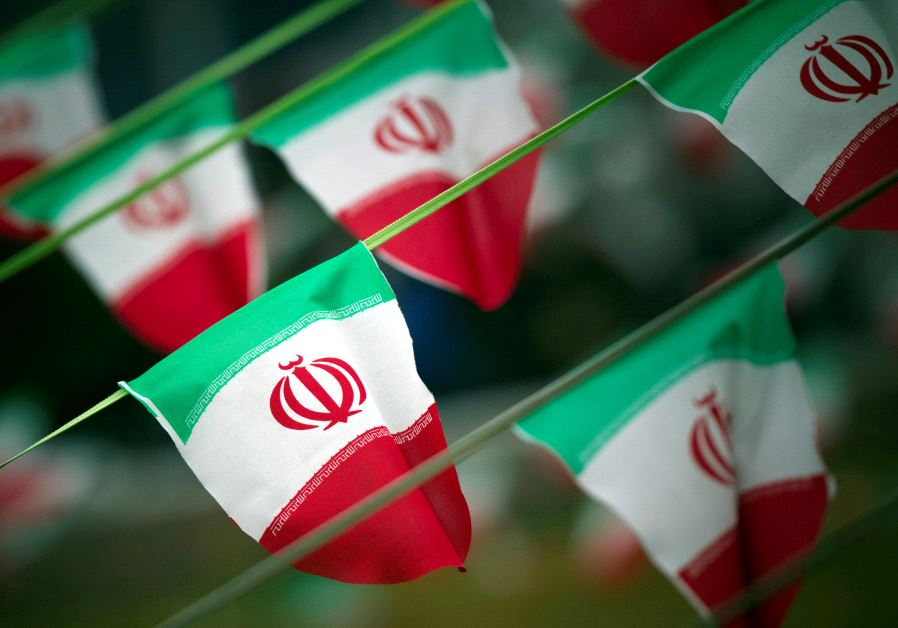 Iran's national flags are seen on a square in Tehran, Iran