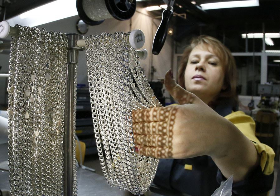 An employee takes silver chains at the jewelry departmen