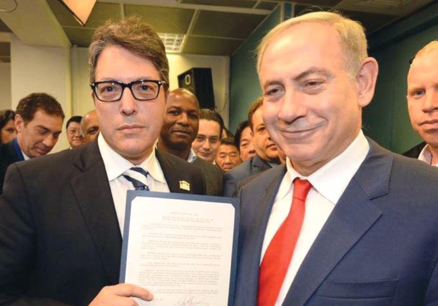 ON A TRIP to Israel in November, Beverly Hills Mayor John Mirisch presents Prime Minister Benjamin N
