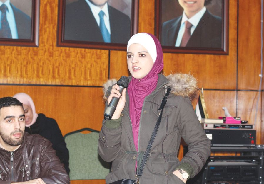 A STUDENT ADDRESSES the conference on Hebrew studies in Amman on December 22