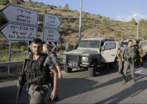 BORDER POLICE officers search the area around the settlement of Dolev after the shooting attack of D