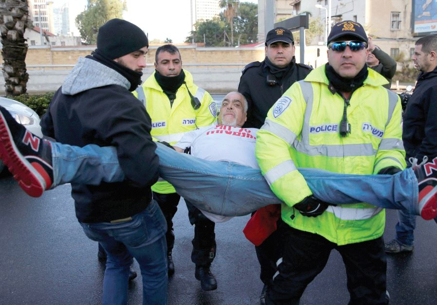 POLICEMEN DETAIN a supporter of convicted soldier Sgt. Elor Azaria during a protest outside the mili