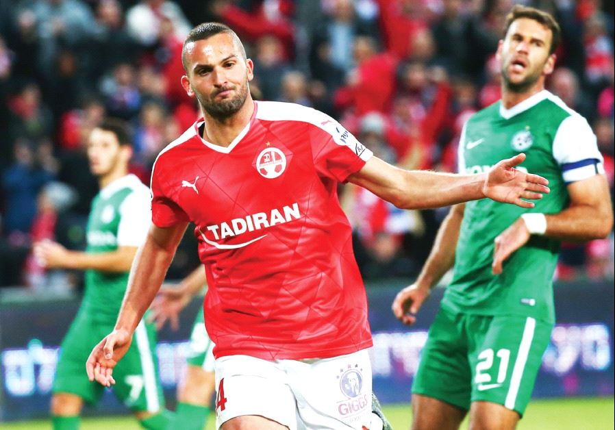 Hapoel Beersheba striker Ben Sahar (in red) celebrates after doubling his team's lead in last night'
