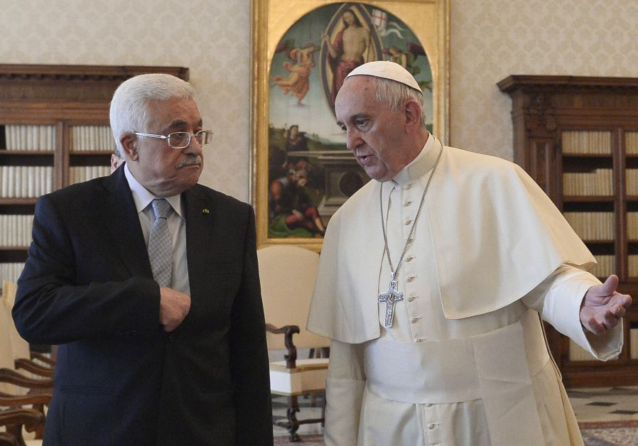 Pope Francis (R) talks with Palestinian President Mahmoud Abbas during a private audience at the Vat
