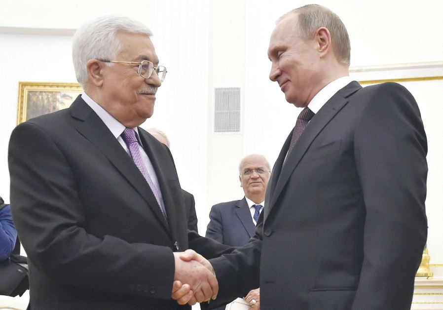 Russian President Vladimir Putin (right) shakes hands with PA President Mahmoud Abbas during their meeting at the Kremlin in Moscow, on April 18 last year (photo credit: REUTERS)