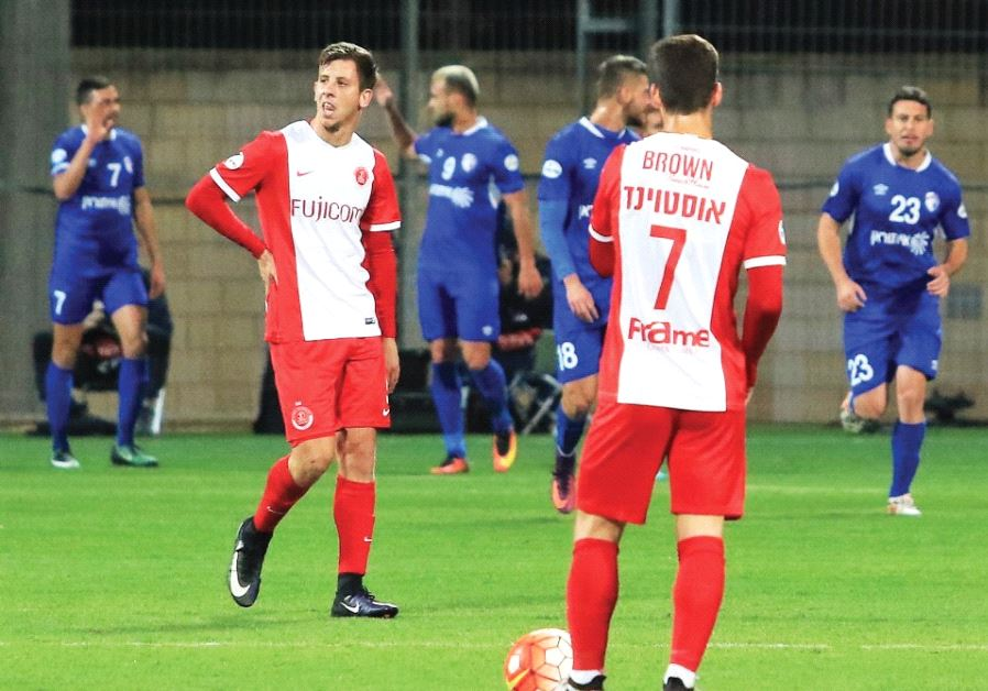 Hapoel Tel Aviv players Ben Reichert (left) and Or Ostvind prepare to renew the game with Ironi Kiry