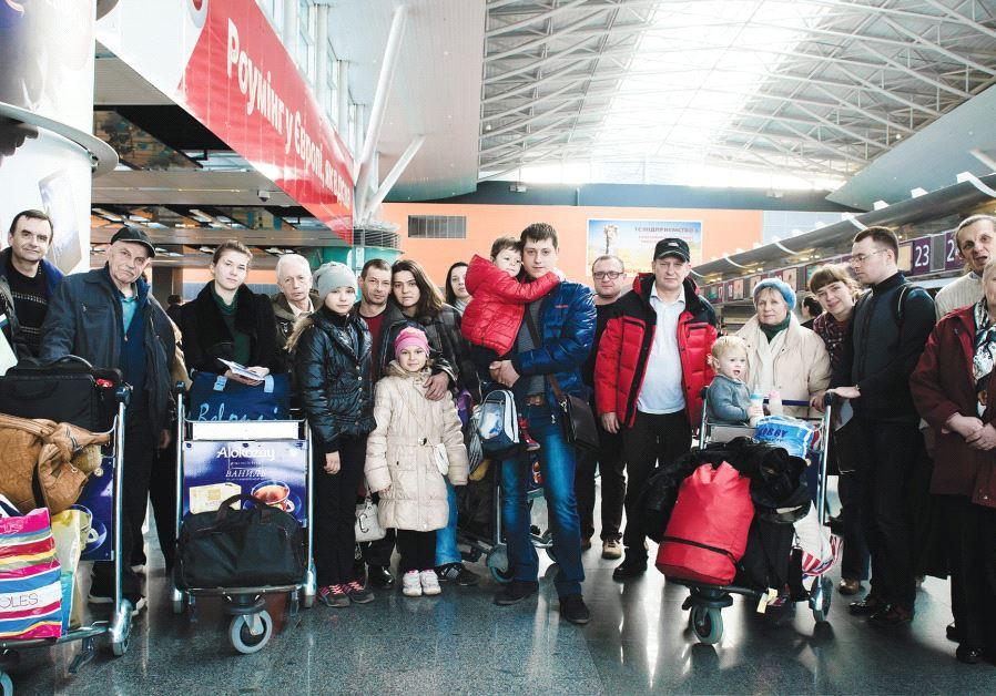 UKRAINIAN OLIM prepare to fly to Israel.