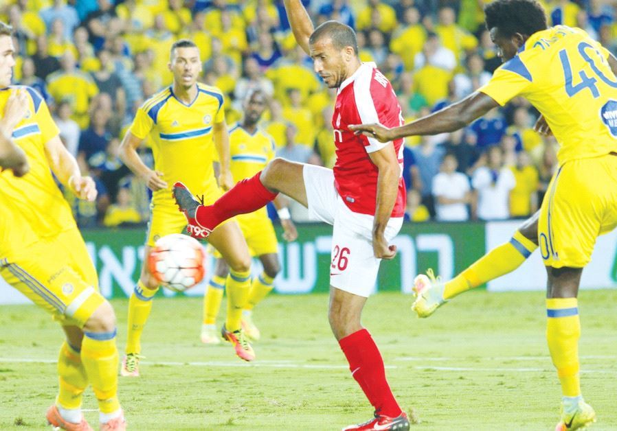 Hapoel Tel Aviv midfielder Avihai Yadin (center) is one of only five of his team's players to surviv