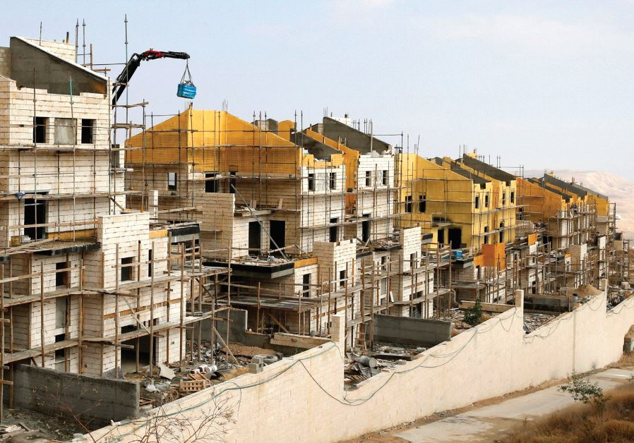 BULIDINGS ARE SEEN last month under construction in the settlement of Ma'aleh Adumim