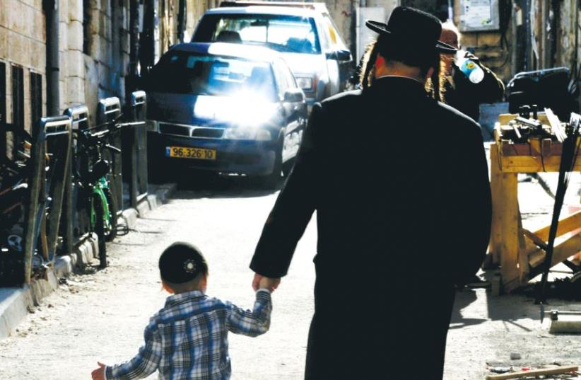 citing half life_A Hassidic man with his child walking in Jerusalem