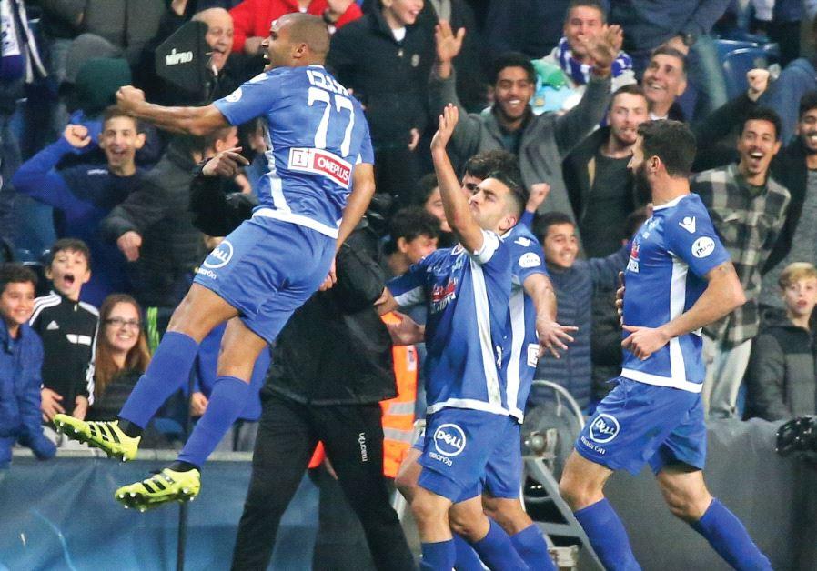 Maccabi Petah Tikva midfielder Uri Magbo (left) celebrates after scoring a 90th-minute equalizer in