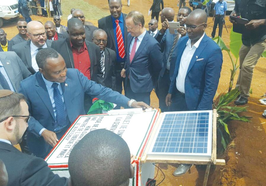 COME MANIRAKIZA, Burundi's energy and mines minister, turns on the light switch