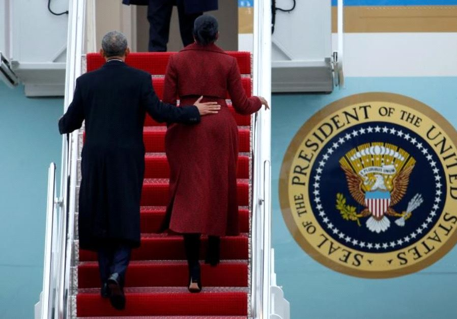 Obama and Michelle board Special Air Mission 28000, a Boeing 747 which serves as Air Force One