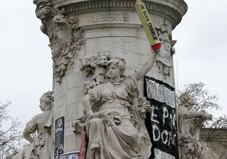 THE STATUE at the Place de la République in Paris is seen featured with a giant cardboard pencil rea
