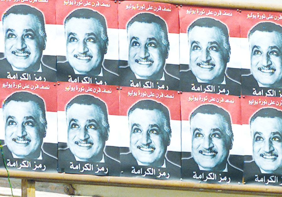 A BILLBOARD with images of former Egyptian president Gamal Abdel Nasser, who pressured Morocco to pr