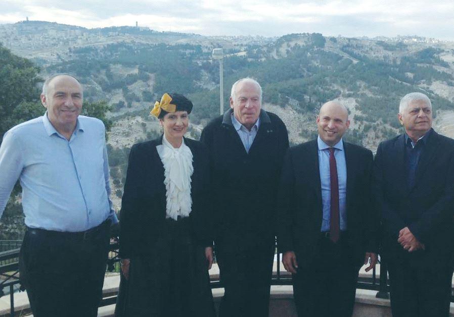 MA'ALEH ADUMIM Mayor Benny Kashriel (third right) poses on January 2 with, from left, Bayit Yehudi's