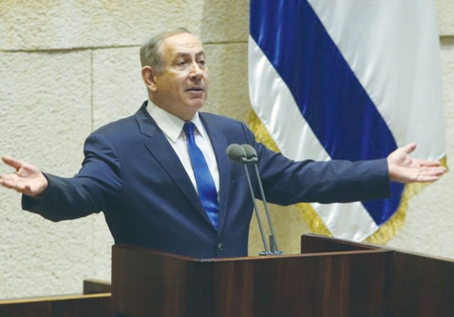 PRIME MINISTER Benjamin Netanyahu speaks during question time at the Knesset yesterday