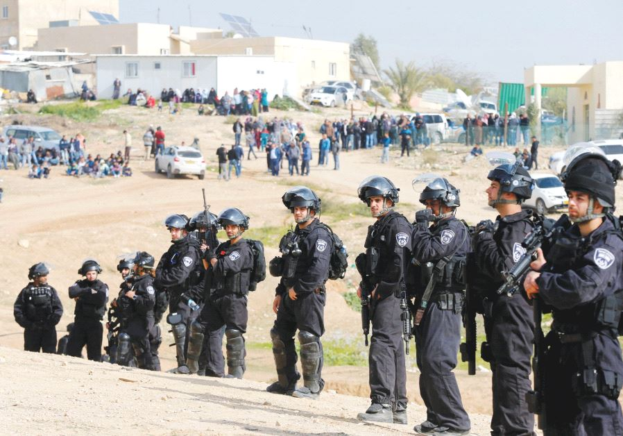 POLICE PROVIDE security for a home demolition in the Negev.