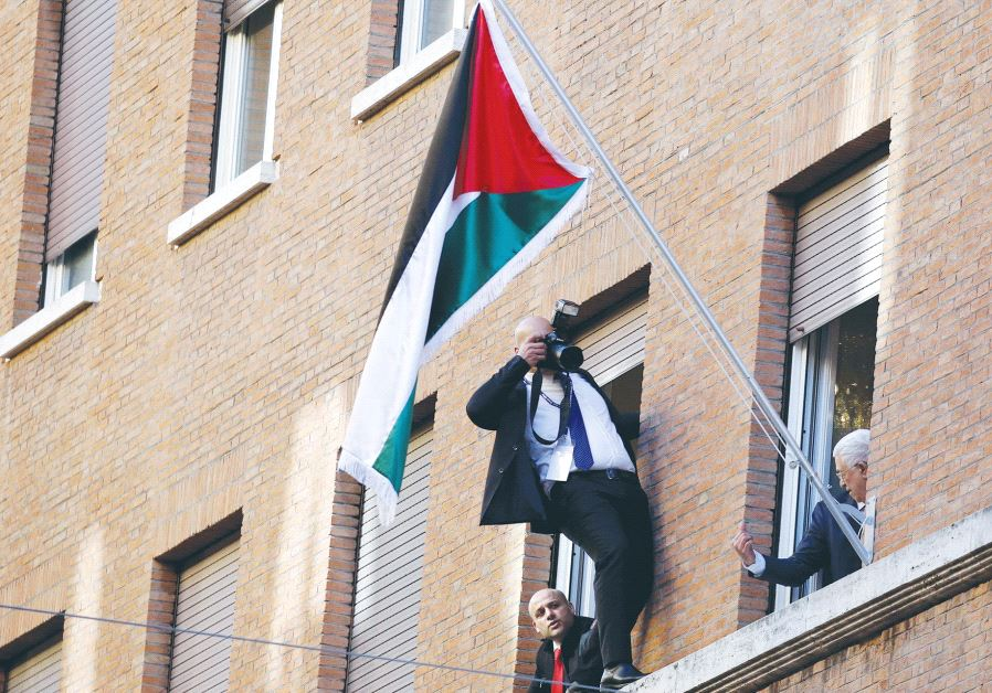 PALESTINIAN AUTHORITY PRESIDENT Mahmoud Abbas looks out a window during the inauguration ceremony of