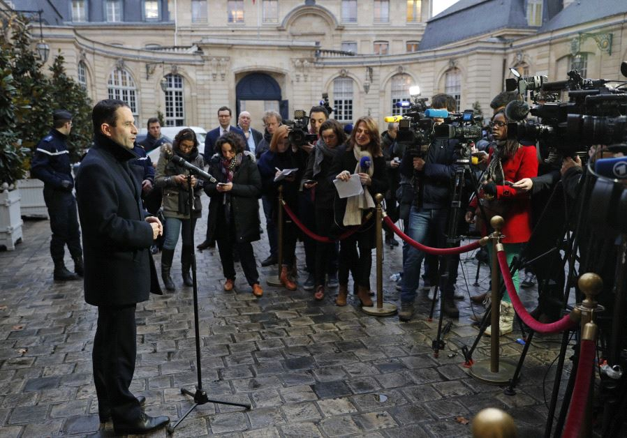 Benoit Hamon (L), French Socialist party's 2017 presidential candidate, talks to journalists as he l