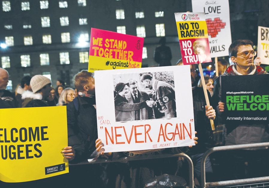 DEMONSTRATORS IN LONDON hold a protest rally yesterday against US President Donald Trump's executive