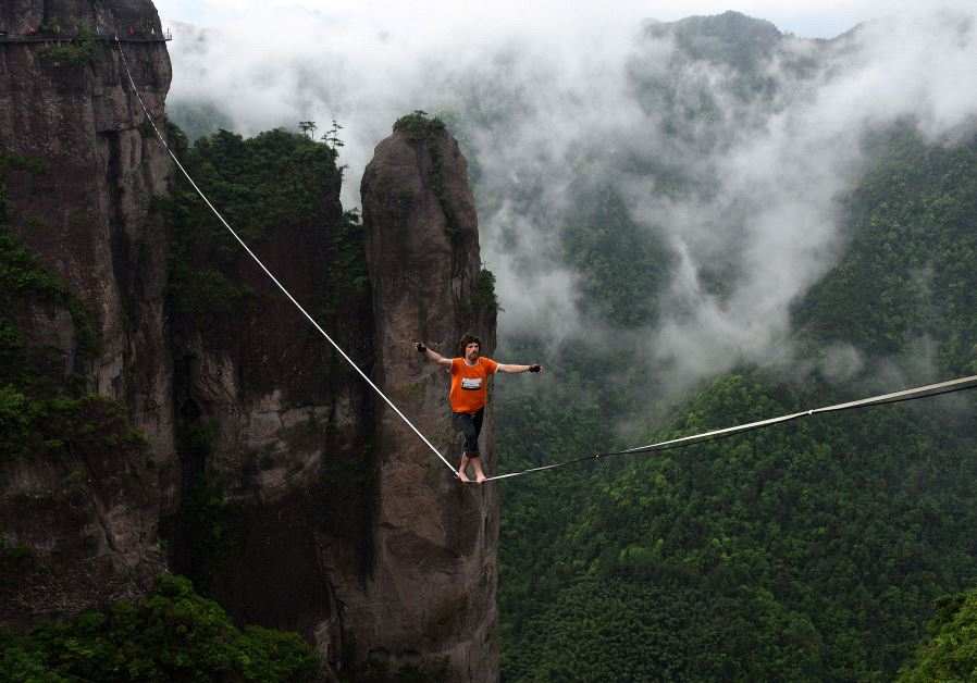 A competitor walks on tightrope