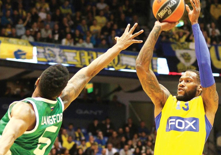 American forward Sonny Weems (right) shoots over Unics Kazan's Keith Langford last Thursday in what