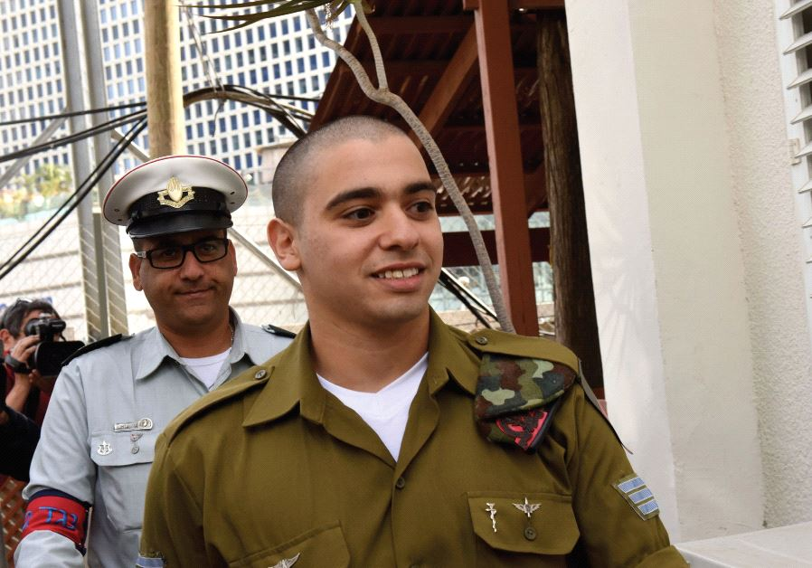 Sgt. Elor Azaria arrives at a military court in Tel Aviv on January 24 for the beginning of hearings