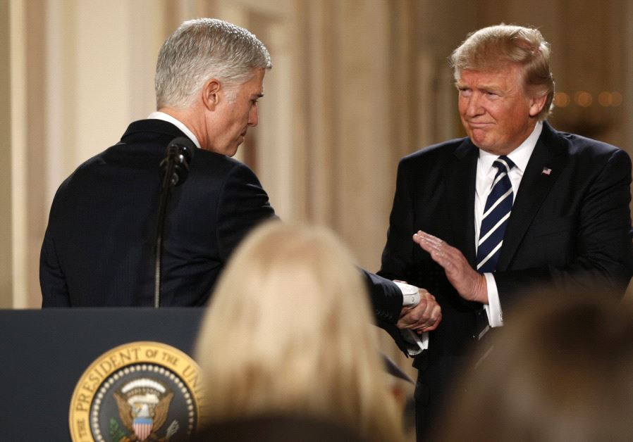 Donald Trump and Neil Gorsuch shake hands