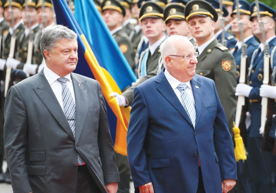PRESIDENT REUVEN RIVLIN walks with his Ukrainian counterpart, Petro Poroshenko, during a welcoming c