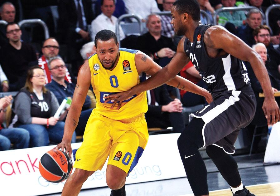 Maccabi Tel Aviv guard Andrew Goudelock (left) scored a team-high 22 points in last night's 90-75 de