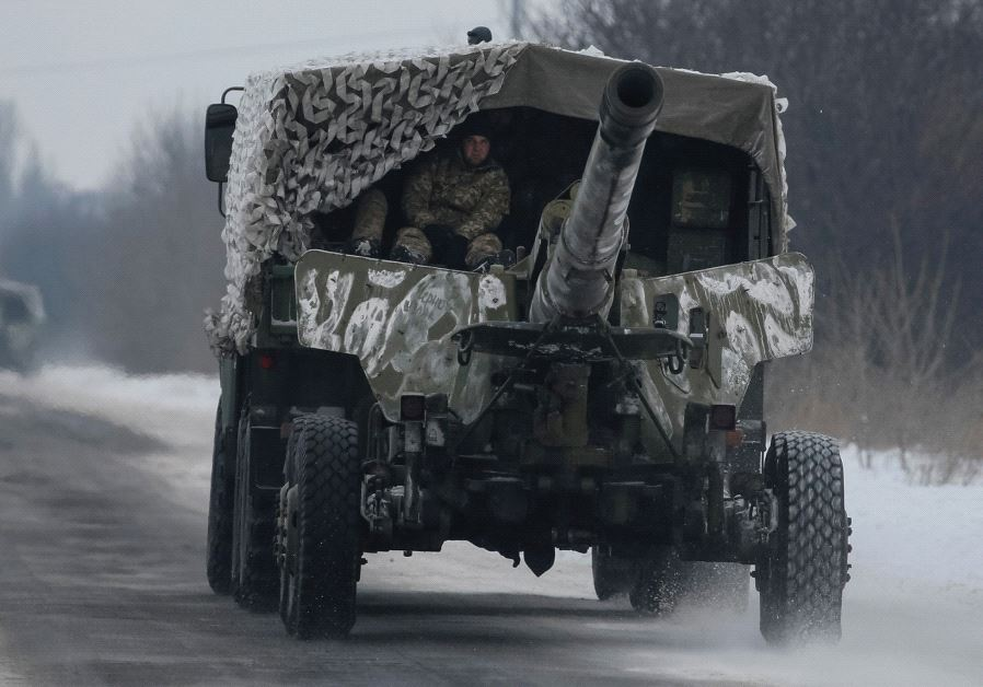 A UKRAINIAN military vehicle rushes to the front as fighting flares in Ukraine between separatists a
