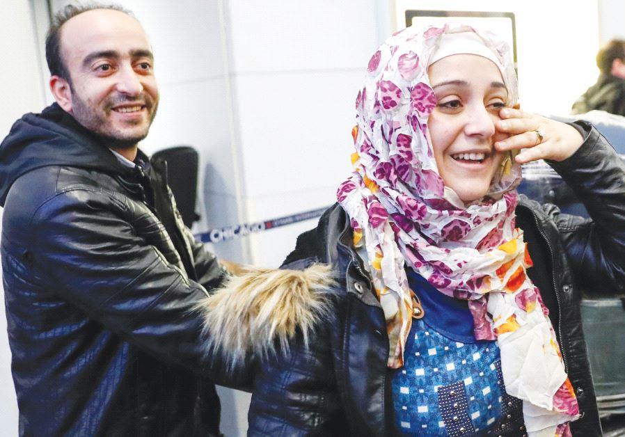 SYRIAN REFUGEES Baraa and her husband Abdulmajeed Haj Khalaf smile after arriving at O'Hare Internat