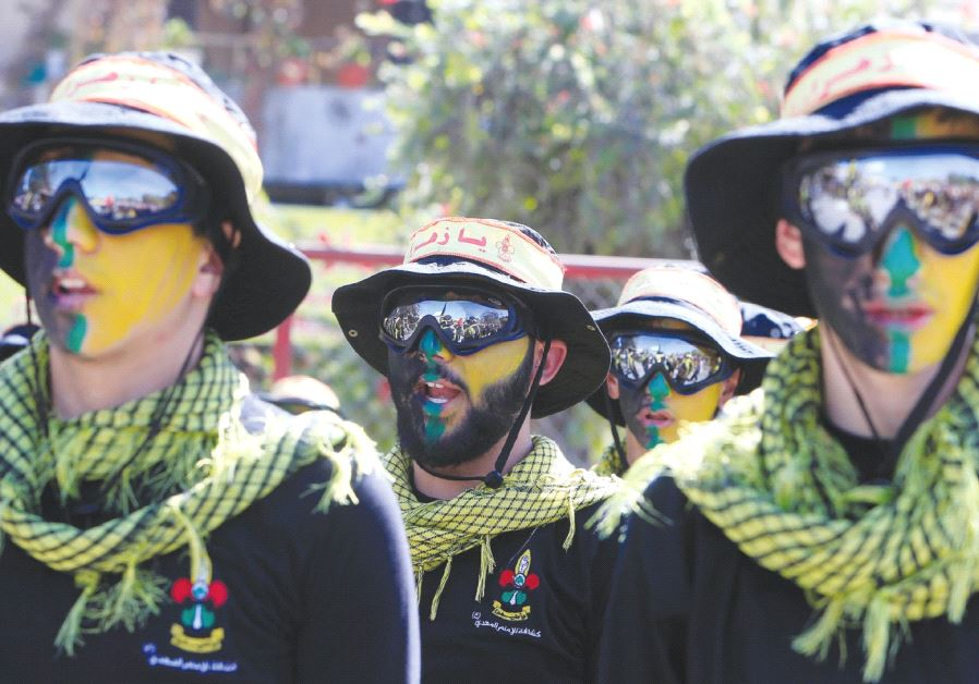 HEZBOLLAH MEMBERS march during a religious procession in Nabatiyeh in southern Lebanon last October