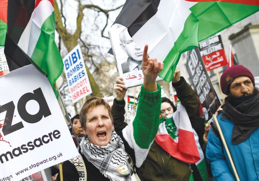PEOPLE PROTEST against Prime Minister Benjamin Netanyahu as he visits British Prime Minister Theresa