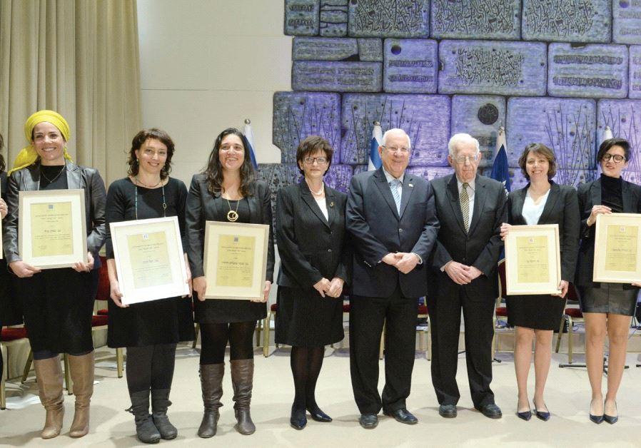 PRESIDENT REUVEN RIVLIN, flanked by retired judge Tehiya Shapira and Prof. Shlomo Avineri, poses wit