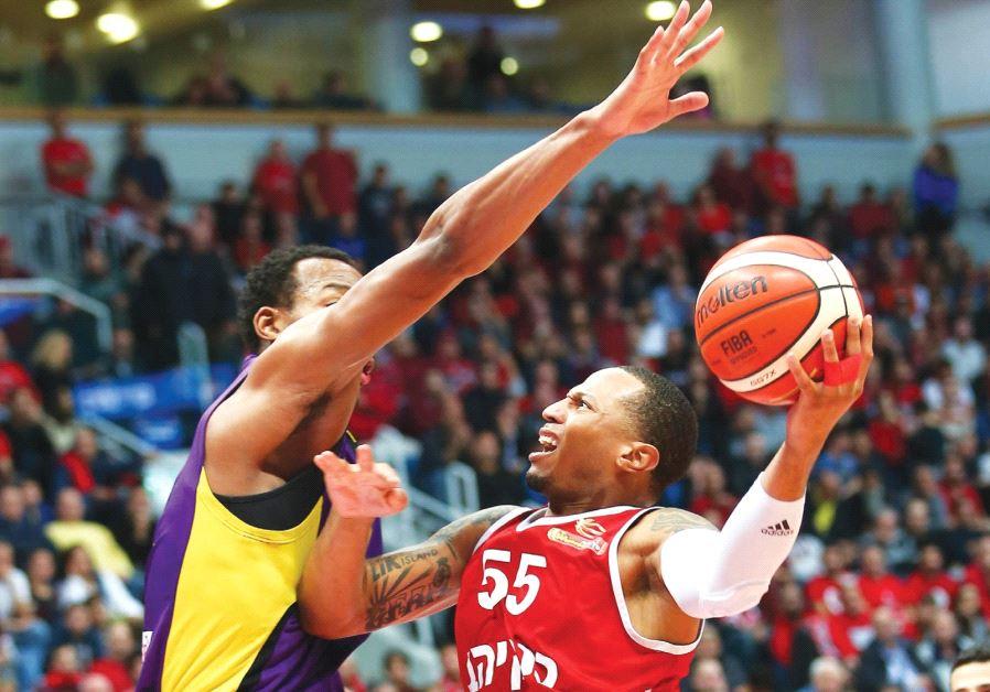 Hapoel Jerusalem guard Curtis Jerrells beats Hapoel Holon's Darion Atkins to the basket during last