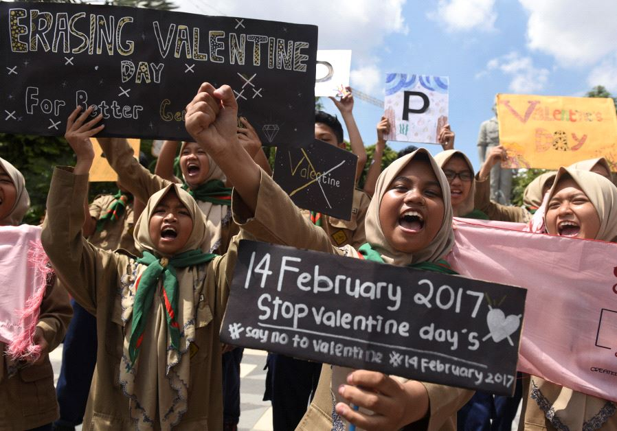 Muslim students shout slogans during a protest against Valentine's Day celebrations in Surabaya, Ind