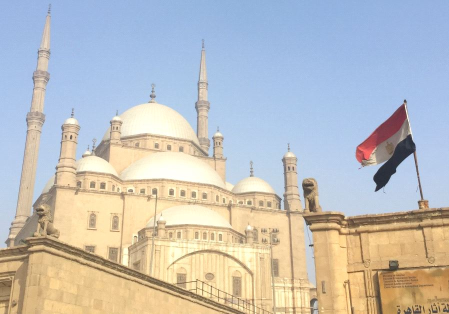 AN EGYPTIAN flag flutters in front of the Muhammad Ali mosque in Cairo.