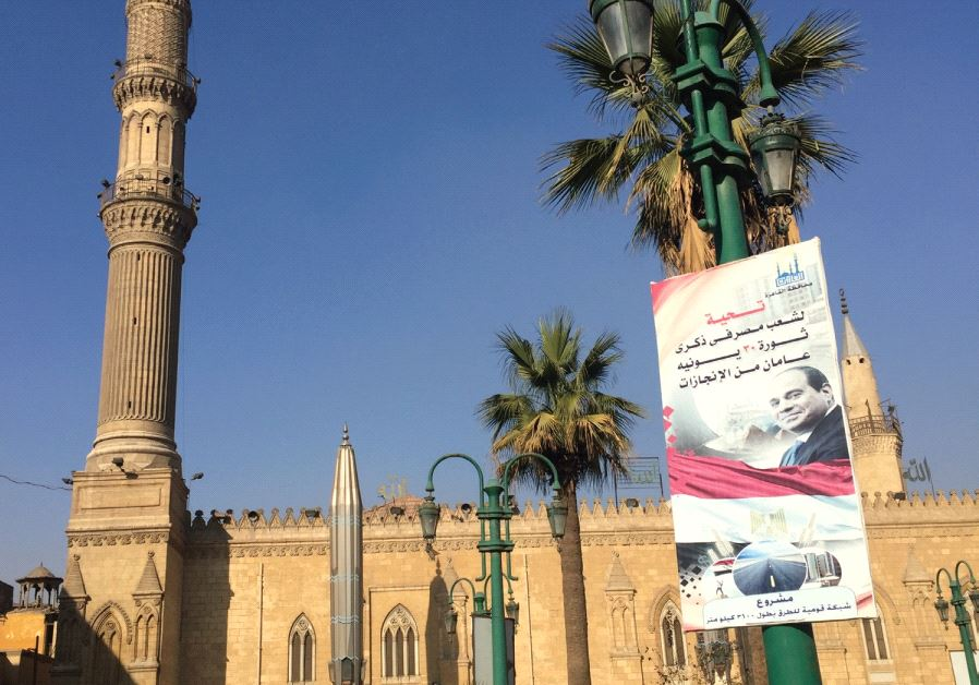 A poster of Egyptian president Abdel Fatah al-Sisi hangs outside Al-Azhar University in Cairo, the S