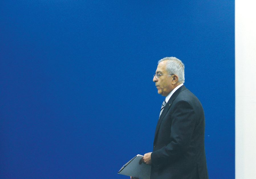 THEN-PALESTINIAN AUTHORITY Prime Minister Salam Fayyad arriving at a meeting in Ramallah in 2012.