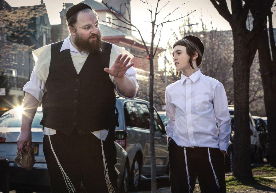 YIDDISH ACTORS Menashe Lustig (left) and Ruben Niborski star in 'Menashe.'