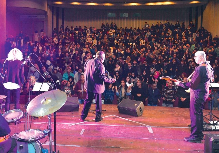 ROY YOUNG and his band play for Arab and Jewish students at the Lod Cultural Center on Thursday.