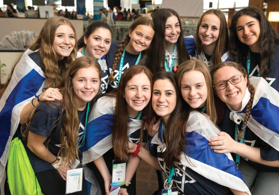 Teenage girls smile while attending the BBYO international convention in Dallas.