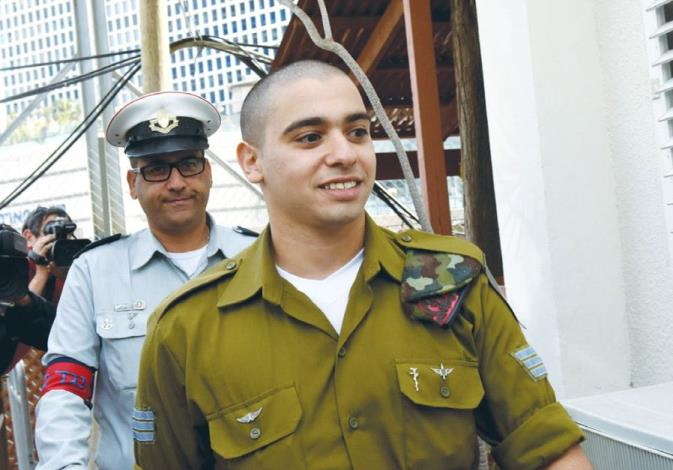 SGT. ELOR AZARIA, convicted of manslaughter for killing a terrorist, arrives for a sentencing hearin